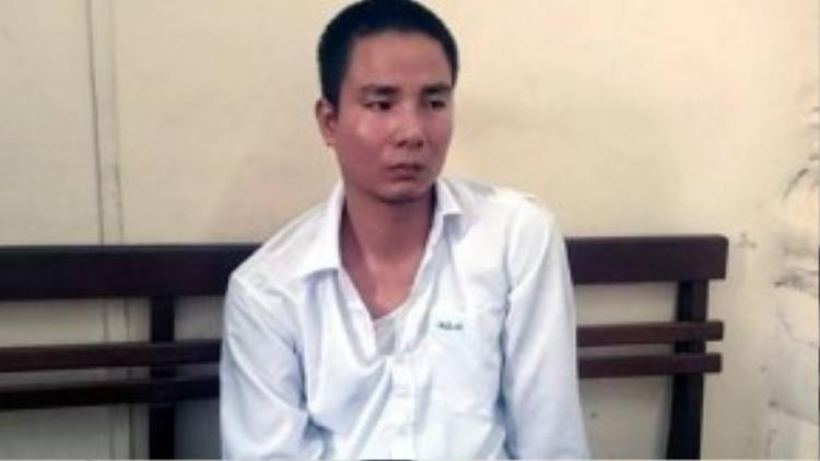 Lái xe Nguyễn Văn Dũng tại trụ sở công an.