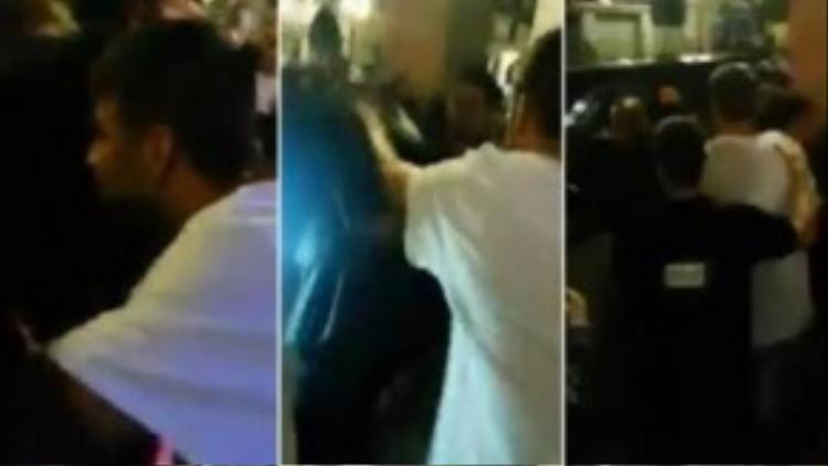Pique chạy khỏi hộp đêm trong sự hộ tống của Lực lượng an ninh.