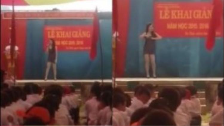 Cô gái mặc váy ngắn, vừa hát vừa nhảy uốn éo trên sân khấu ngày khai giảng. (Ảnh chụp từ clip)