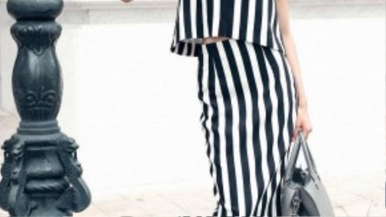 Trong bộ sưu tập Xuân Hè 2016 của nhà thiết kế Đỗ Mạnh Cường, mốt đen trắng quay trở lại với những thiết kế tối giản và nữ tính hơn.