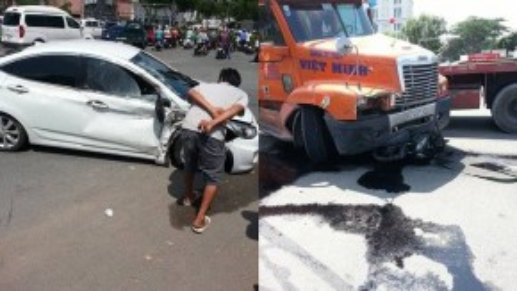 Chiếc xe hơi bị tông trúng và chiếc xe đầu kéo gây tai nạn. (Ảnh: FBNV)