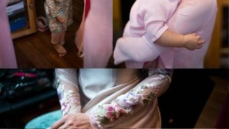 Bạn bè và gia đình nhà gái mặc trang phục màu hồng cánh sen nữ tính, dịu dàng.