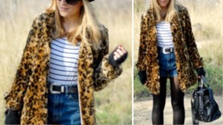 Cô nàng này lại trông thật ngầu khi kết hợp áo thun kẻ sọc với jean shorts và đặc biệt là áo khoác da báo chất chơi.