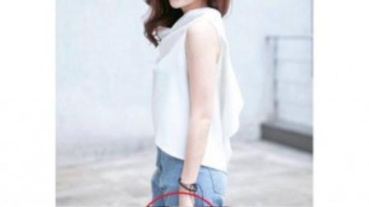 Chiếc ví cầm tay của Hoàng Thùy Linh giống hệt chiếc ví cô gái bí mật để trên bàn khi ôm Vĩnh Thụy.