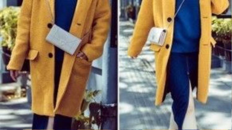 Á hậu Tú Anh diện chân váy denim, áo xanh, áo khoác vàng tạo nên tổng thể tuyệt đẹp trong ngày hẹn hò trời lạnh.