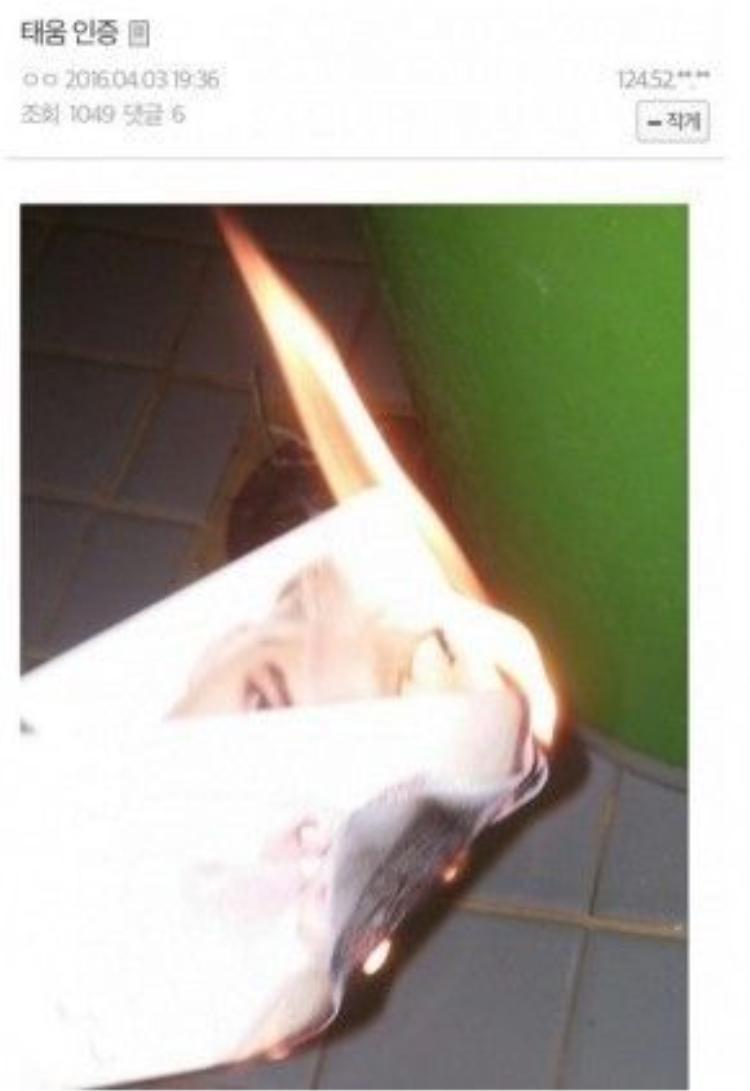 Hình ảnh album của EXO bị cắt và poster của Kai bị fan đốt.