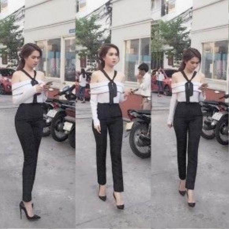 """Nữ hoàng nội y, diễn viên """"vòng eo 56"""" Ngọc Trinh cũng là một trong những tín đồ khá chuộng thời trang thập niên 70s cùng kiểu ống tay dài miên man khi đến ghi hình cho một talkshow của đài truyền hình Việt Nam."""