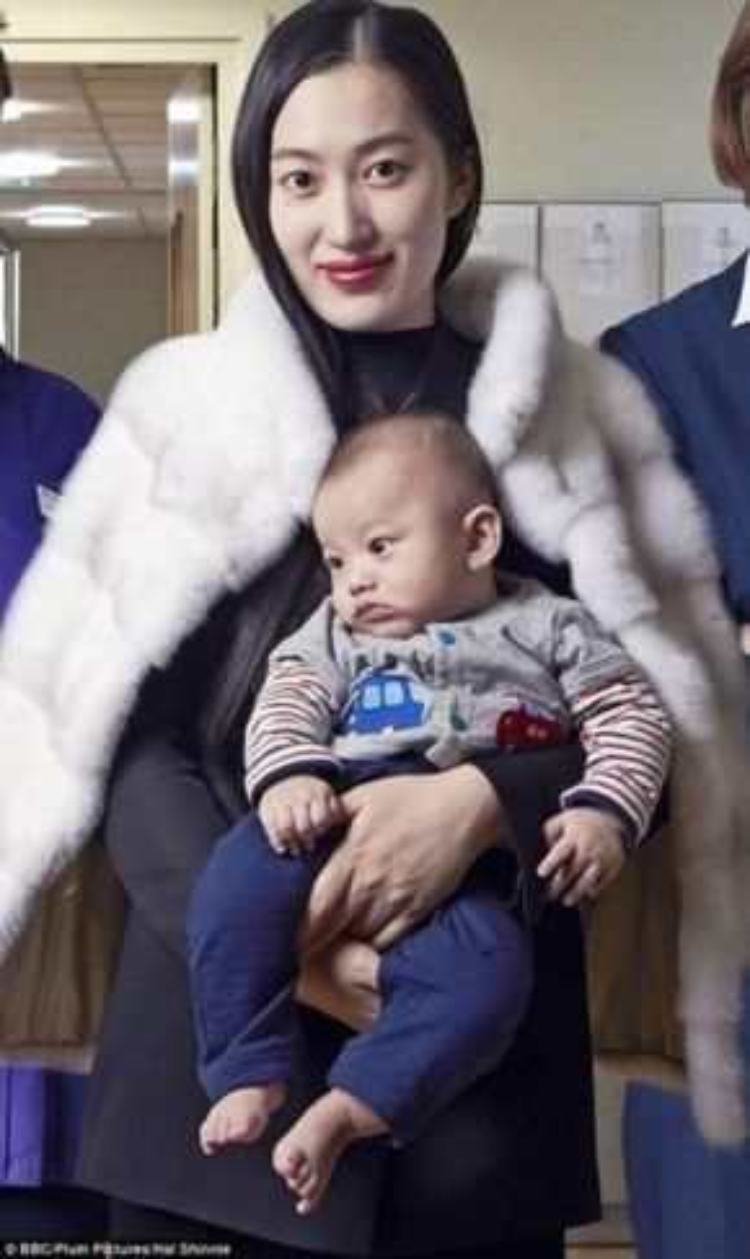 Lu Hui và con trai Lucas hiện tại.