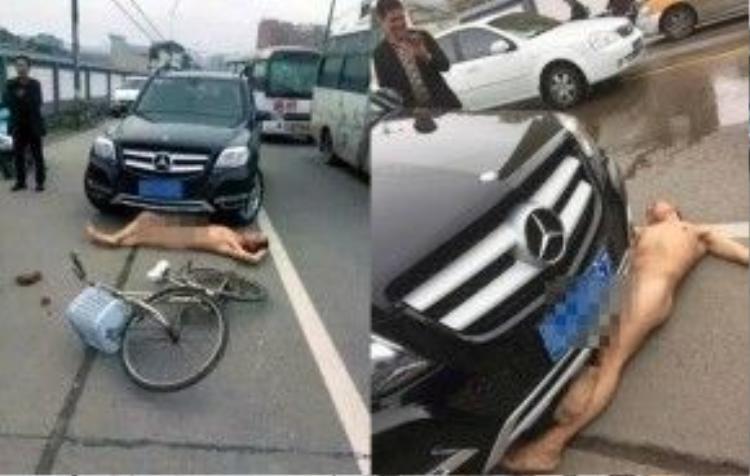 Người đàn ông này khỏa thân nằm lăn trên đường