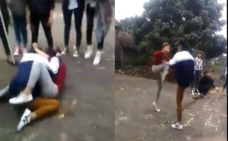 Xuất phát từ mâu thuẫn nhỏ tại trường, trên đường đi học về 2 nữ sinh đã lao vào đánh nhau. (ảnh cắt từ clip).