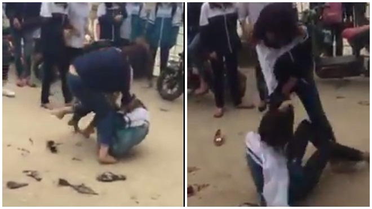 Hai nữ sinh đánh nhau ở Thanh Oai, Hà Nội. Ảnh cắt từ clip.