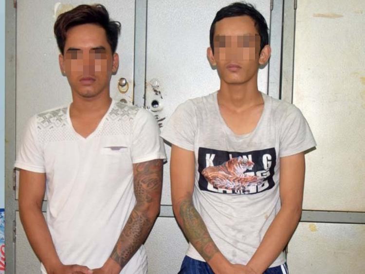 Bức ảnh hai nam thanh niên được cho là kẻ giả mạo.