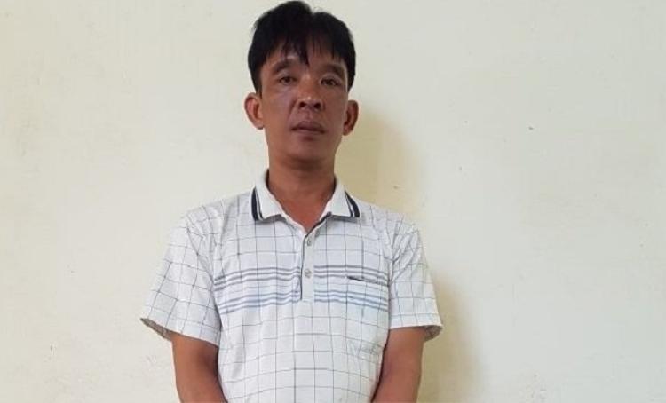 Đối tượng Trần Văn Hùng tại cơ quan công an.