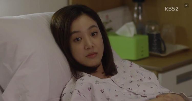 Gương mặt cô chợt bừng sáng khi Jin Wook đến thăm mình.