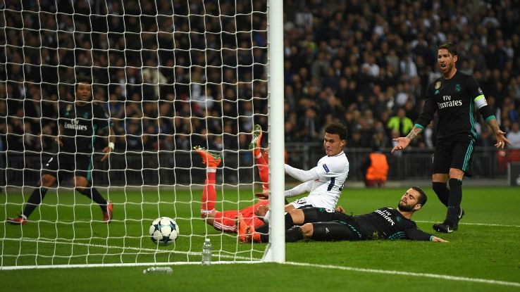 Dele Alli lập cú đúp trong chiến thắng Real Madrid.
