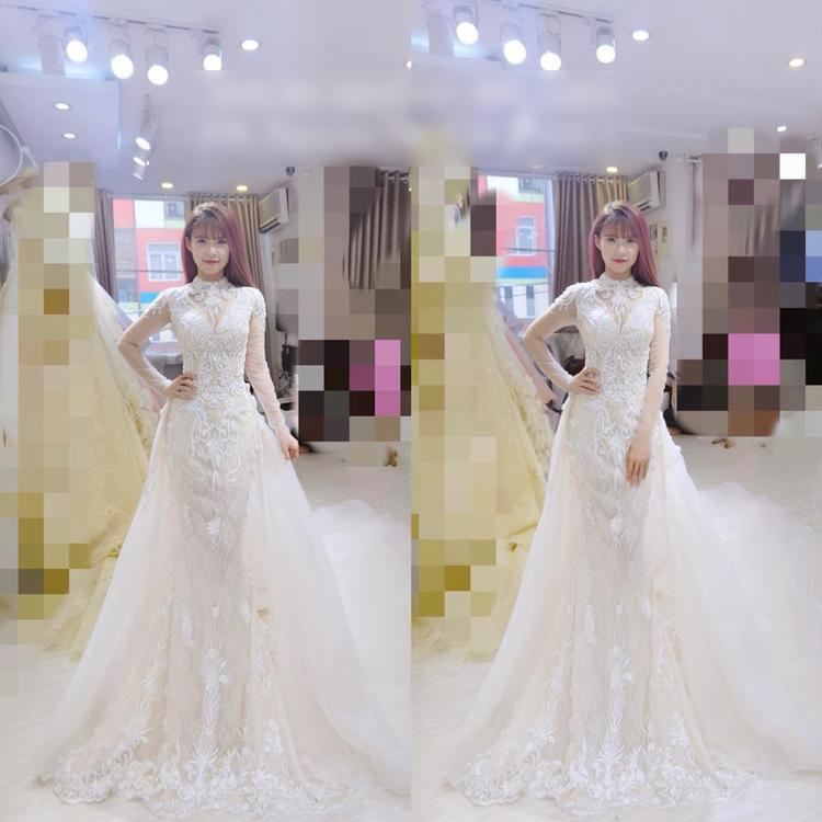 Khởi My xinh đẹp trong bộ váy cưới trắng kín đáo nhưng không kém phần quyến rũ.Nguồn: Facebooker Nguyễn Thị Kim Thịnh