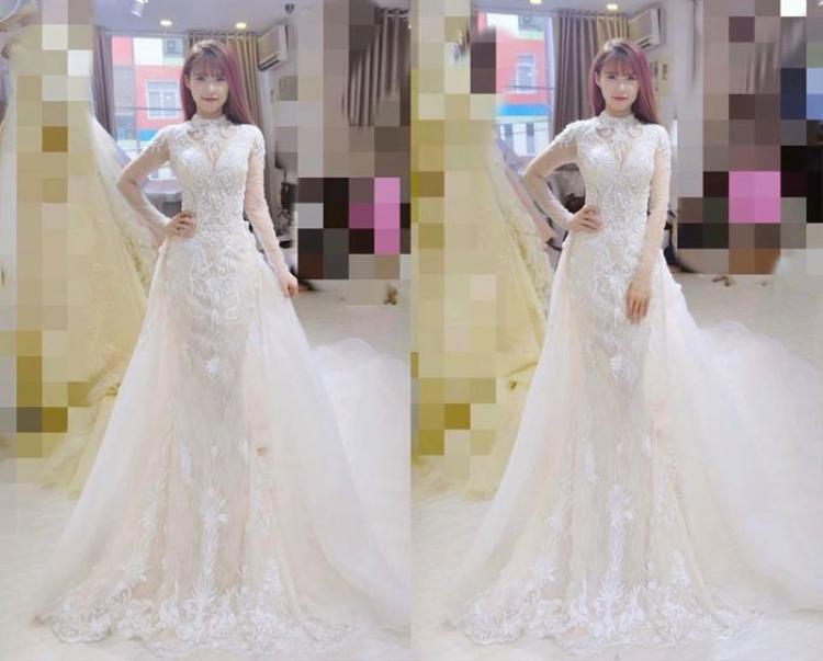 Hình ảnh mới nhất của Khởi My khi đi thử đồ cưới. Nữ ca sĩ xinh đẹp trong bộ váy cưới trắng kín đáo nhưng không kém phần quyến rũ.