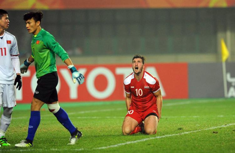 U23 Syria quỳ gối vì bất lực trước khung thành U23 Việt Nam. Ảnh: AFC
