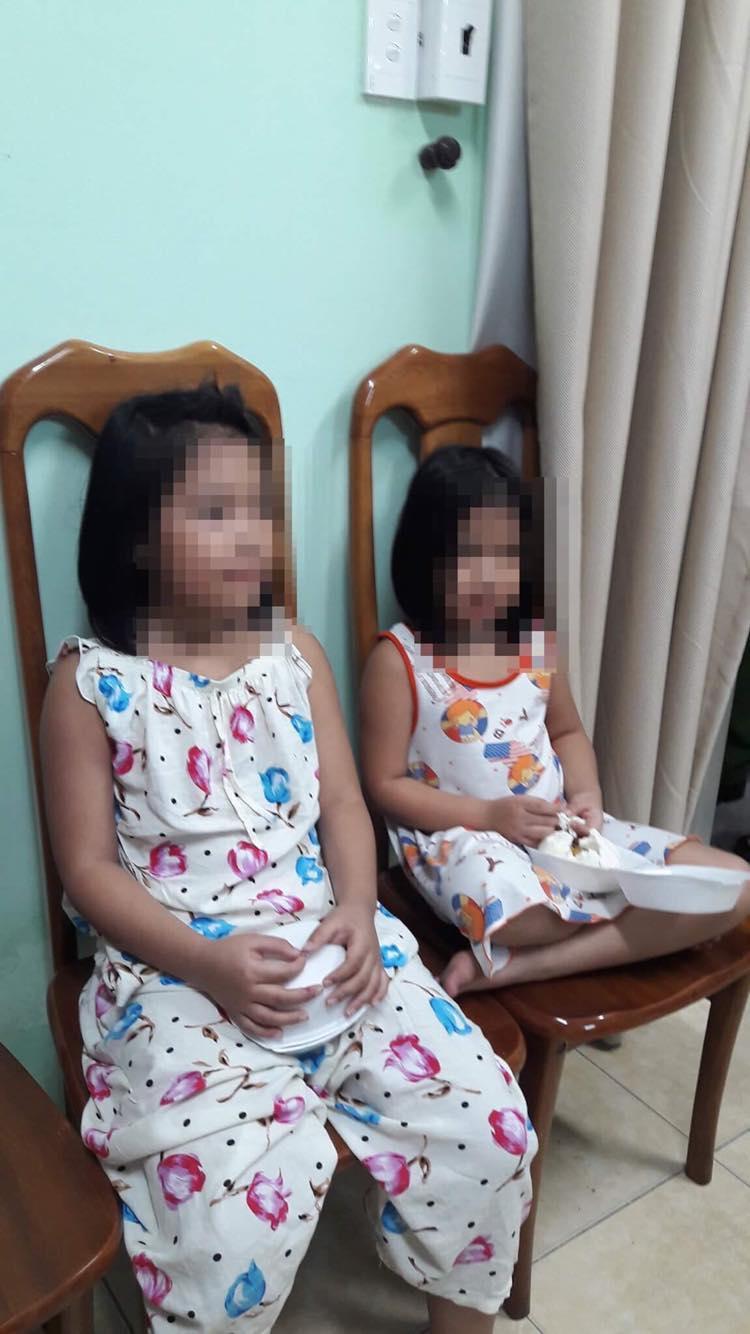 Bé Trần Hoàng M.A (7 tuổi) và Trần Hoàng B.N (5 tuổi).