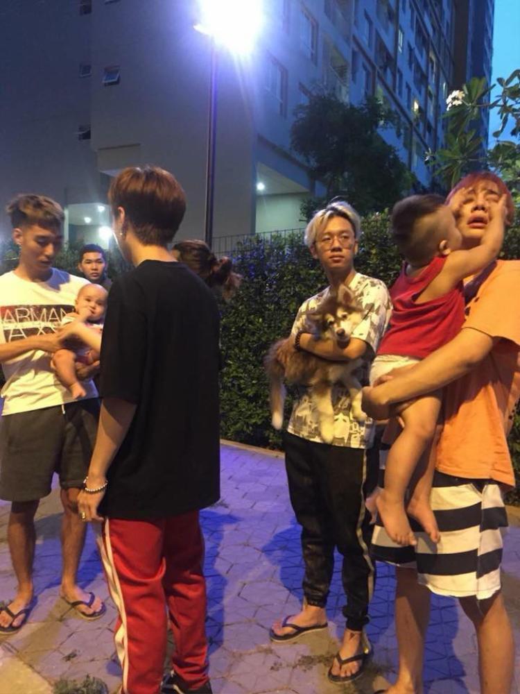 Lou Hoàng ôm con của Only C tháo chạy khỏi đám cháy.