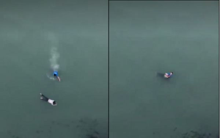Hình ảnh anh Huân lao xuống sông cứu cô gái trẻ.