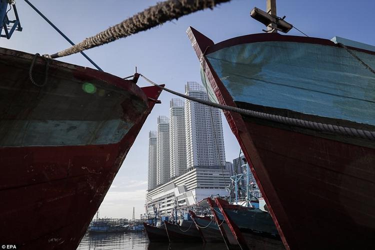 Hiện nay, tại Jakarta, không chỉ những khu ổ chuột mà ngay cả những tòa nhà cao tầng cũng có nguy cơ bị ngập lụt.