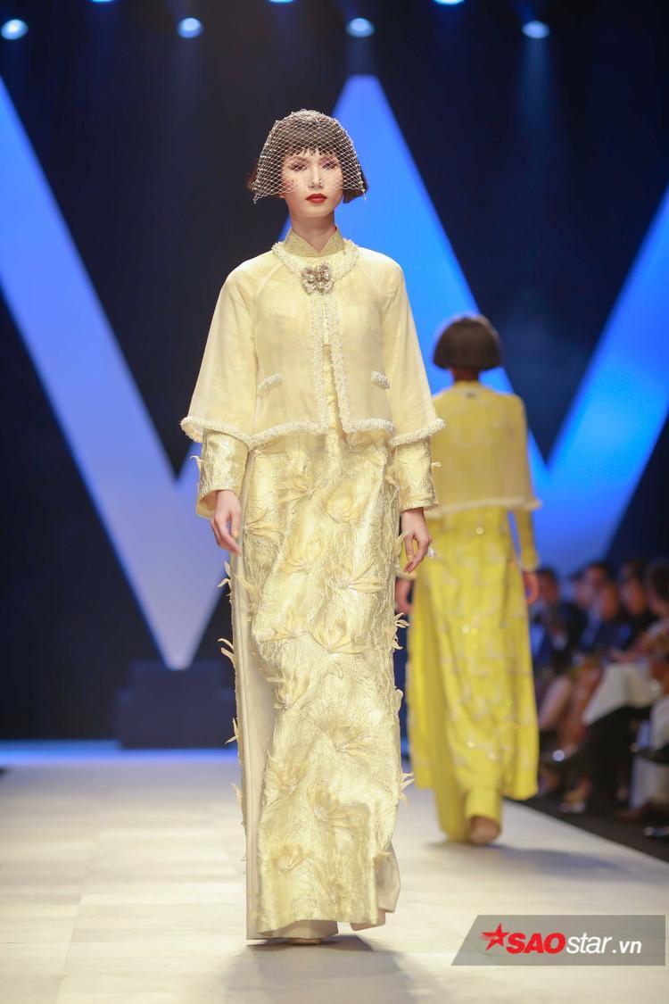 Những chiếc áo vest đặc trưng của Chanel, nay được Công Trí phối cùng áo dài thuần Việt, tạo nên một tổng thể ấn tượng.