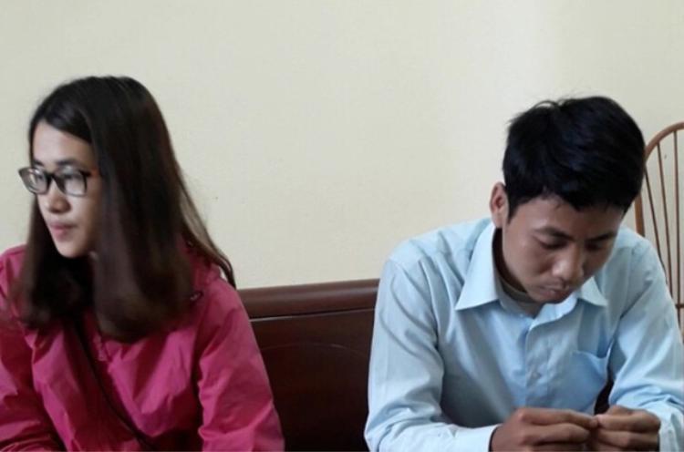 2 vợ chồngTrương Văn Dỏng và Nguyễn Thị Thu tại cơ quan công an. Ảnh: Dân Trí.