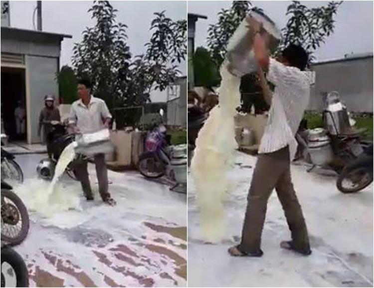 Người đàn ông đổ sữa lênh láng ra đường - (Ảnh cắt từ clip).