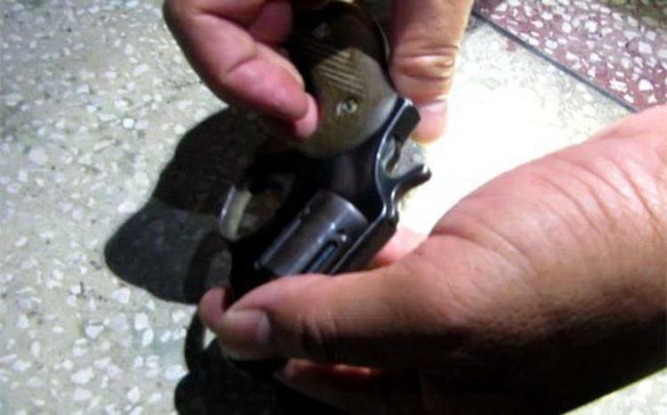 Khẩu súng colt của Mỹ (loại súng ám sát) đã lên đạn của đối tượng Triệu Tử Nam