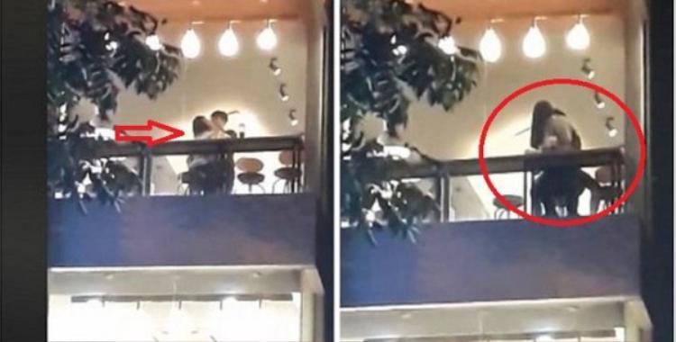 Cặp đôi vô tư âu yếm ở nơi công cộng. Ảnh cắt từ clip