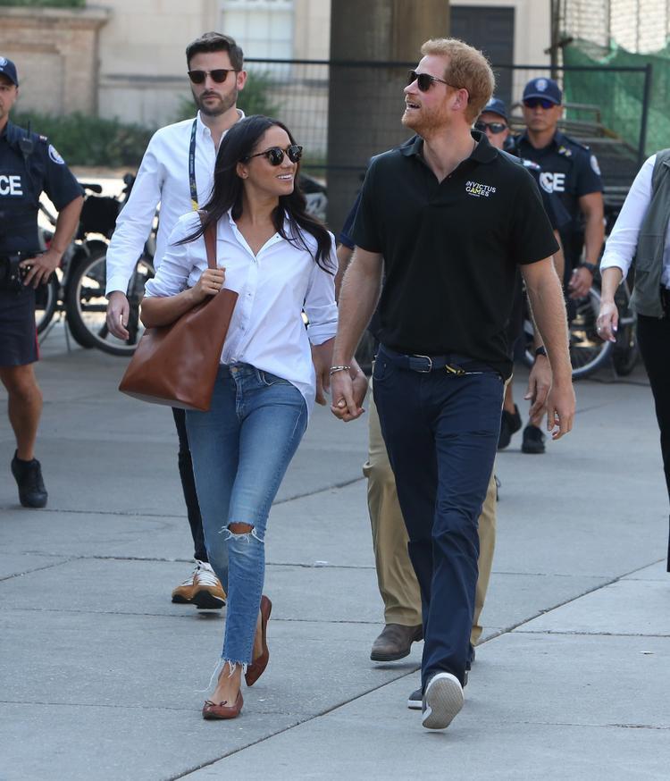 Hoàng tử Harry và Meghan Markle đến xem trận đấu tennis tại Invictus Games ở Toronto, Canada. Ảnh: Splash News