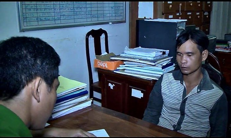 Lê Văn Hé tại cơ quan điều tra.