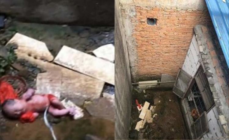 Em bé bị phát hiện trên một khoảng đất bẩn thỉu trong bức tường cao gần 2 m. Ảnh: AsiaWire