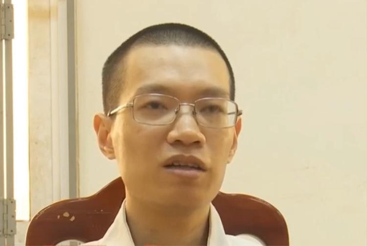 Nguyễn Anh Tú tại cơ quan công an.