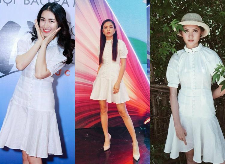"""1. Mẫu đầm trắng tay bồng với thiết kế tinh giản nhưng đầy nữ tính, tinh khôi và kín đáo đúng chuẩn mực """"gái ngoan"""" được các mỹ nhân Việt lăng xê không ngừng."""