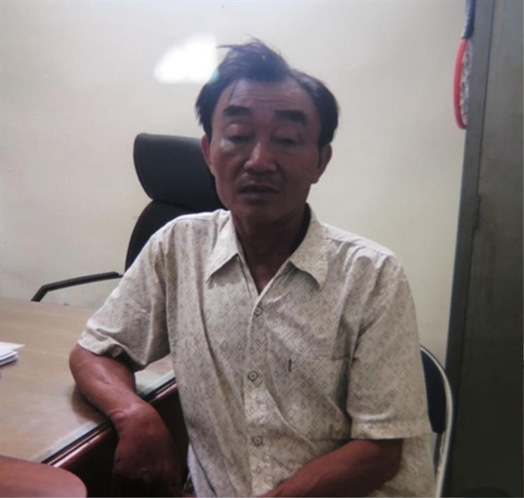 Chân dung đối tượng Nguyễn Khanh tại trụ sở công an - (Ảnh Người lao động)