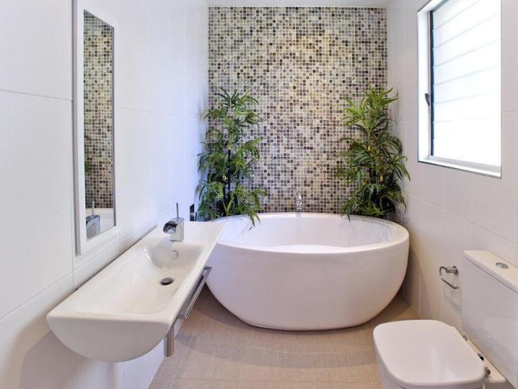 Không quá cầu kì cho một nhà tắm hẹp nhưng vẫn đem tới sự trang nhã, hài hòa trong tổng thể.
