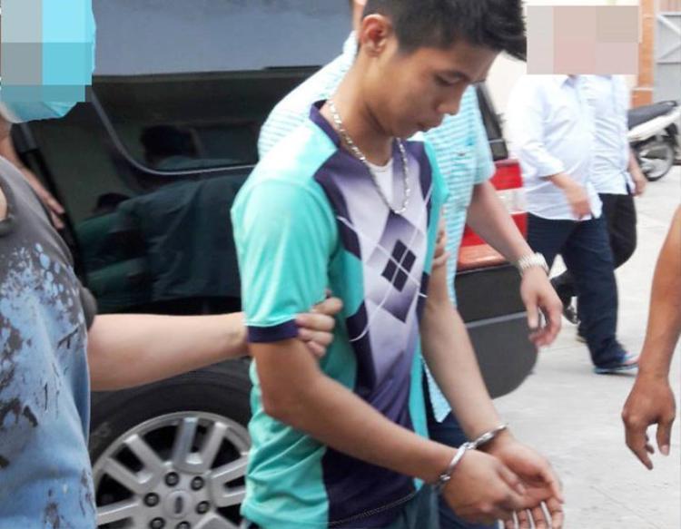 Nguyễn Hữu Tình khi bị dẫn giải về điều tra. Ảnh: Zing.