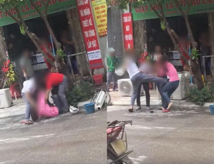 Hình ảnh người chồng tung cước đá vào bụng vợ để bảo vệ cô gái được cho là nhân tình - (Ảnh cắt từ clip).