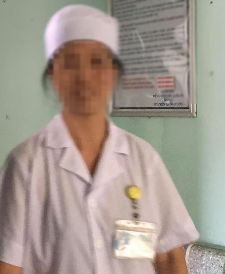 Nữ hộ sinhVũ Thị Thanh Mai vô cùng sốc sau sự việc trao nhầm con cách đây 6 năm.