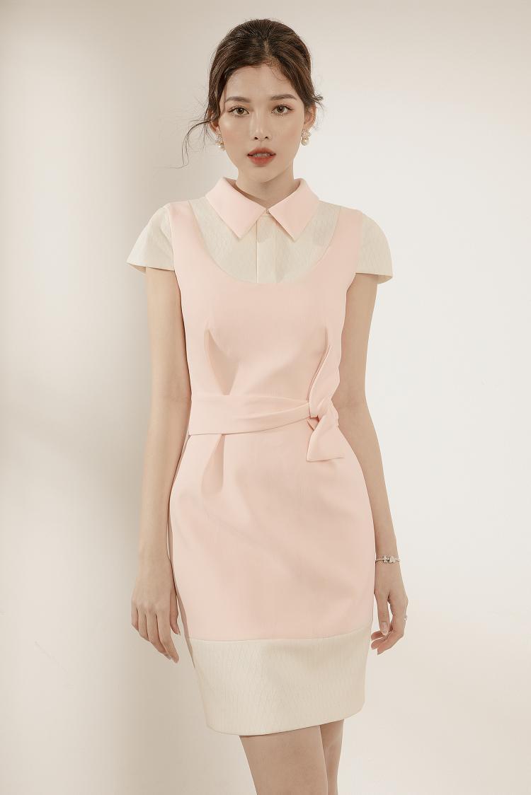 Gam màu hồng pastel trang nhã tô điểm với chiếc nơ ngang eo.