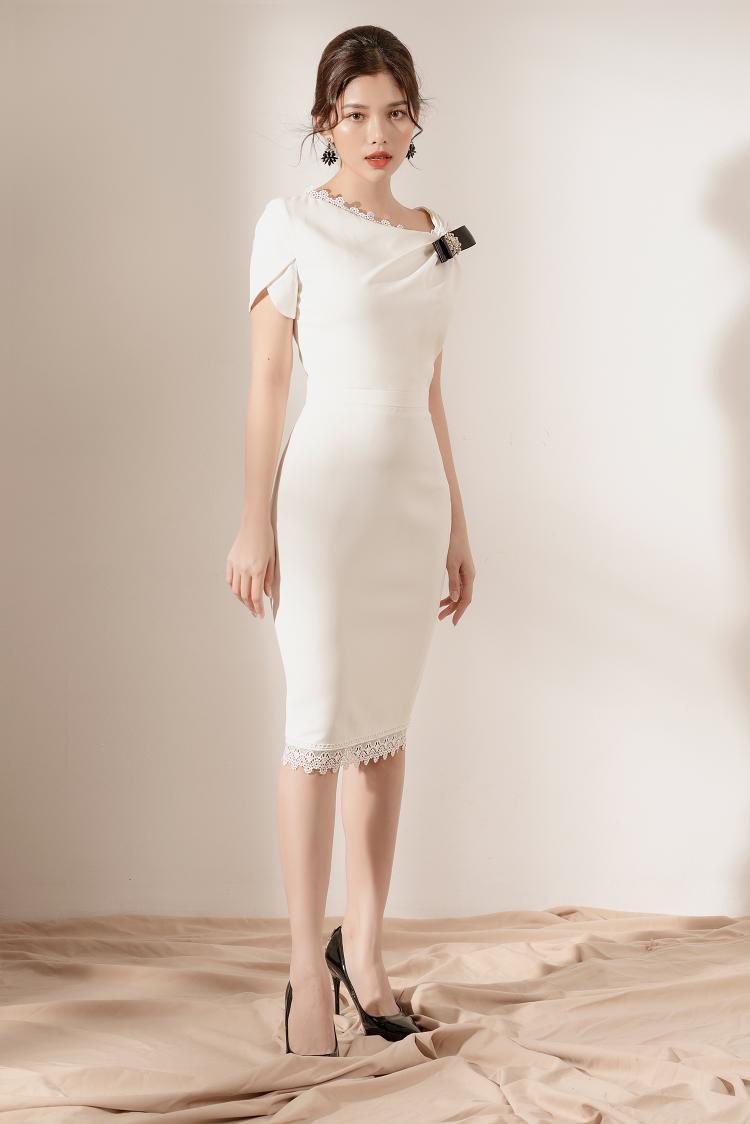 Thiết kế bất đối xứng thổi một làn gió mới cho phom dáng váy ôm cơ bản.