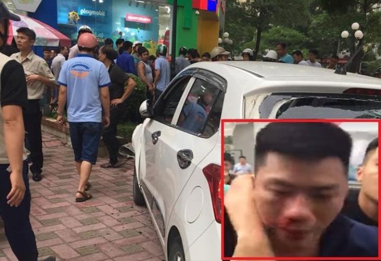Nam tài xế bị người dân khống chế giao cho lực lượng chức năng. Ảnh: Gia đình Việt Nam.