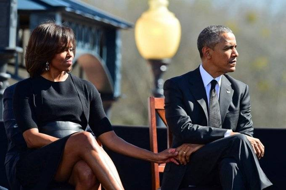 Phu nhân Obama luôn âm thầm sát cánh với chồng trong bất kỳ sự kiện nào.