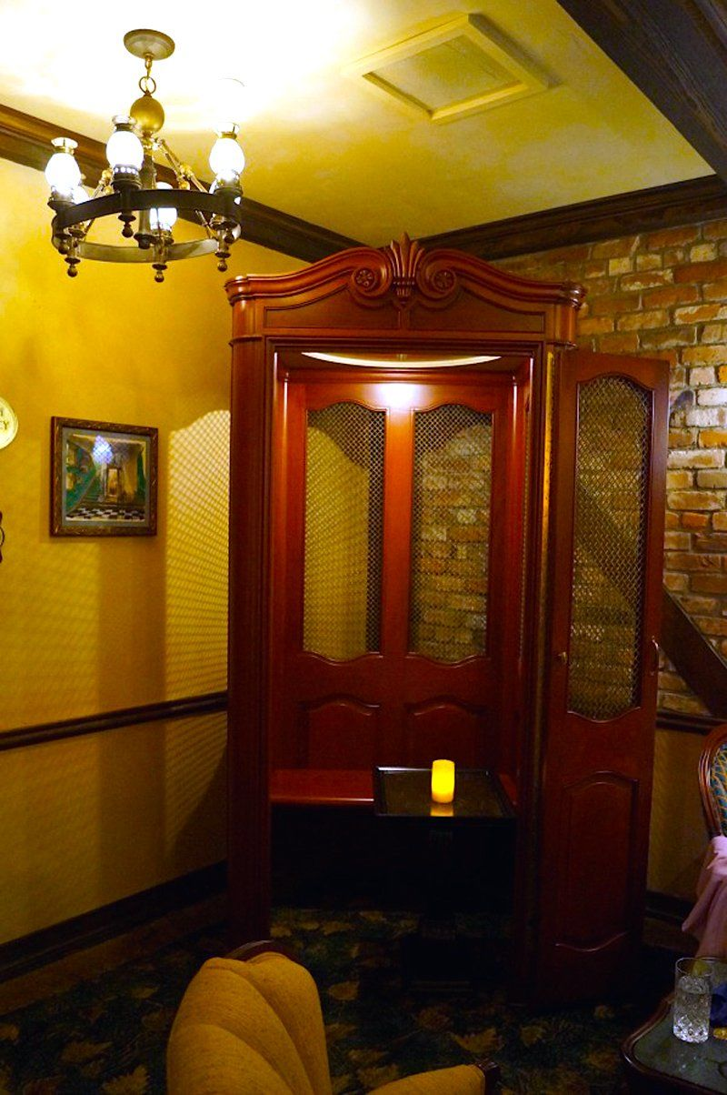Inside the reception area is a French elevator Disney had specially made for the building. Since it's no longer up to code, it was turned into a booth — though some fans weren't too pleased it was remodeled, according to Doyle.