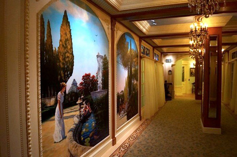 "The walls of Club 33 are lined with paintings — Doyle said they made the theme ""The Princess and the Frog."""
