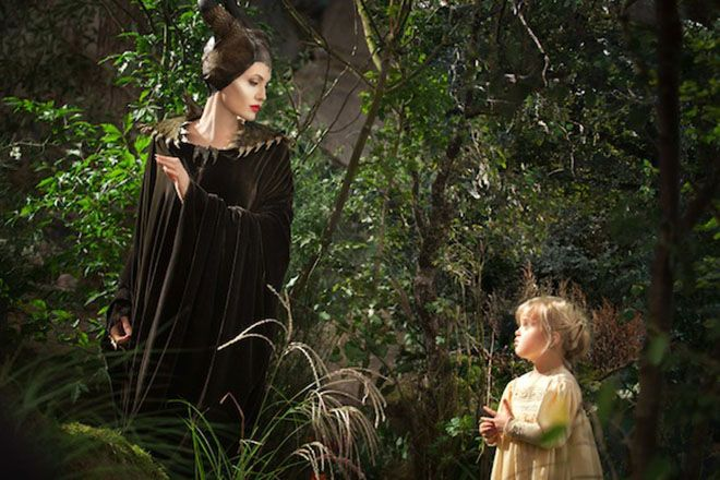 Disney's MALEFICENT L to R: Maleficent (Angelina Jolie) and Young Aurora (Vivienne Jolie-Pitt) Ph: Frank Connor ©Disney Enterprises, Inc. All Rights Reserved.