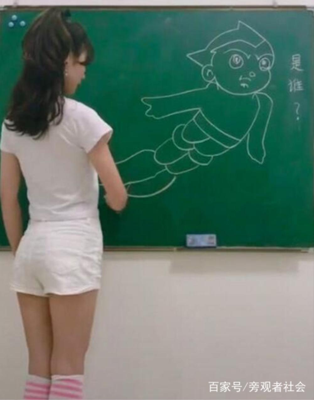 Cô giáo mầm non ăn mặc gợi cảm khi đứng lớp khiến phụ huynh tranh cãi dữ dội Ảnh 1