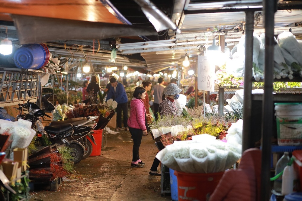 Chùm ảnh: Những con người không ngủ đón đông cùng Hà Nội Ảnh 4